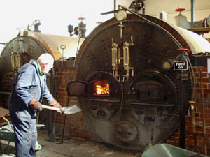 Association member stocking the boiler at the Papplewick Pumping Station